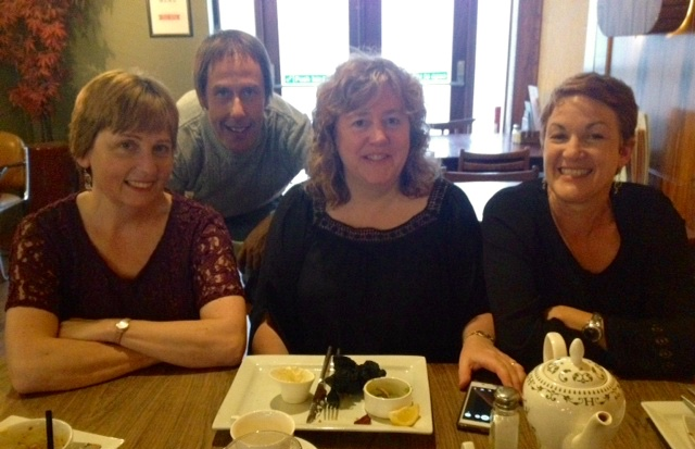 One Voice For Care ensemble musicians pictured around a dining table prior to concert.