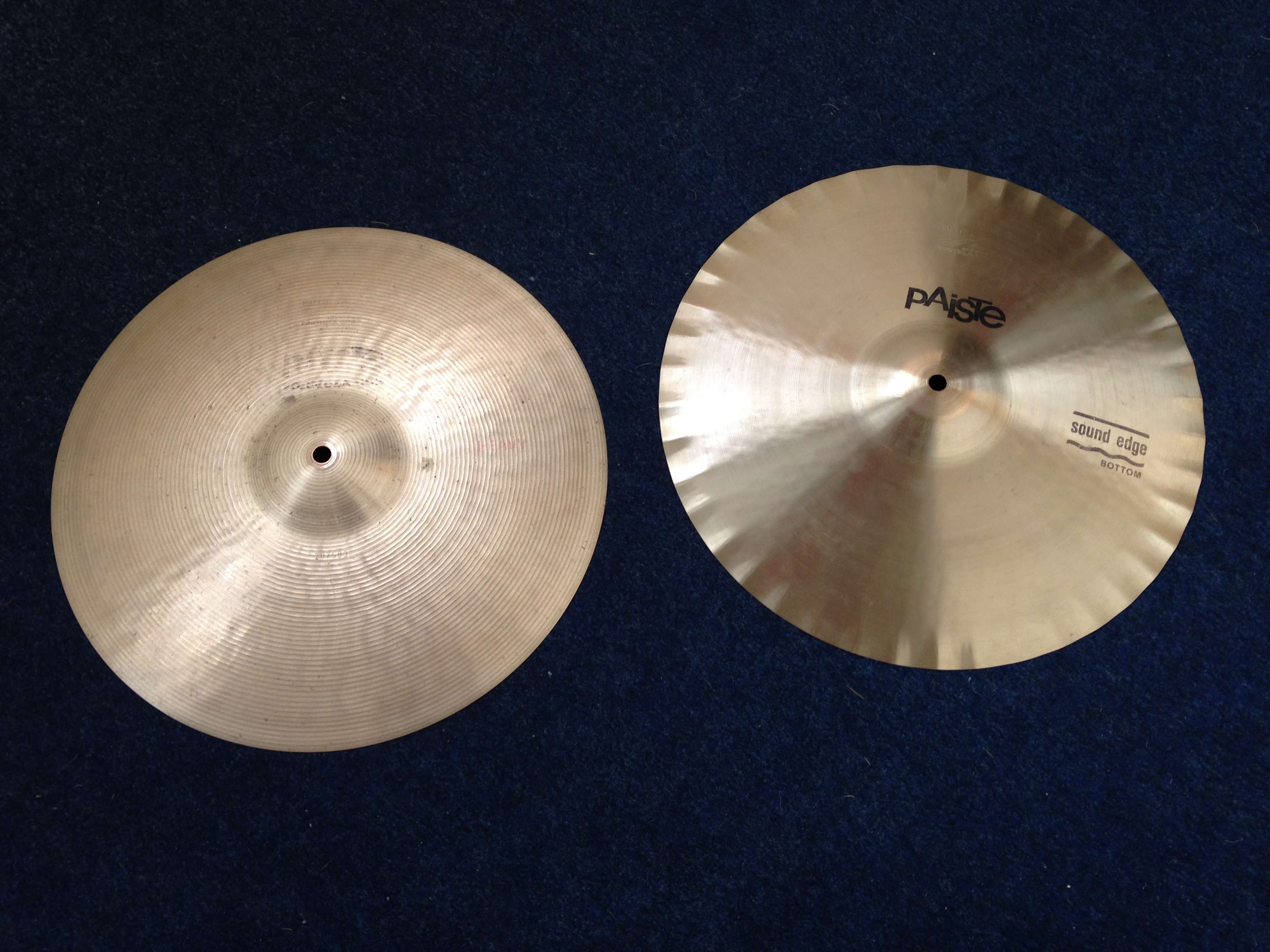 """A picture of a pair of Paiste 602 15"""" song edge hi hats"""
