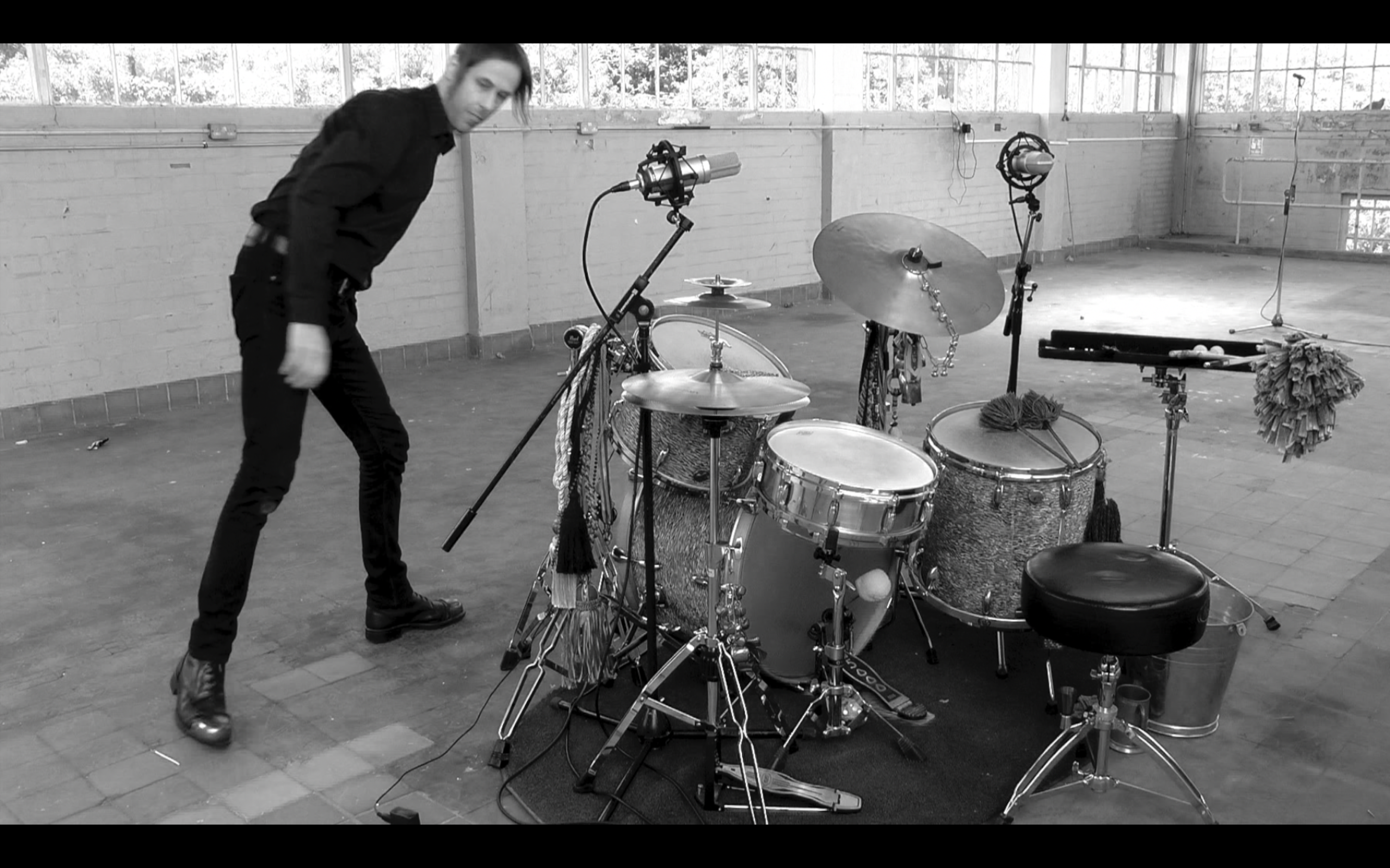 Lee Allatson and his drum set (black and white)