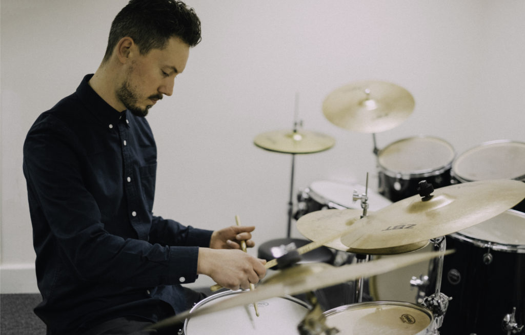 A picture of Euan Rodger - a teacher at Dye House Drum Works - playing drums!