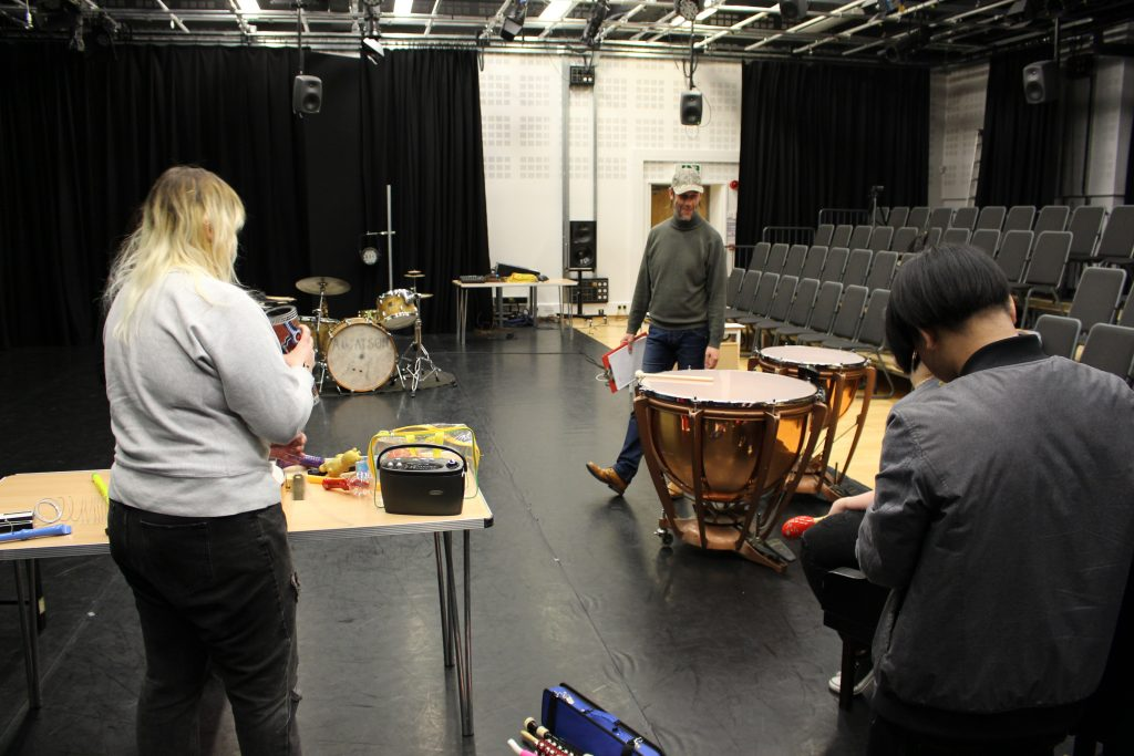 Studio lecture room photograph of students working on I am Just a Little Emotional workshop