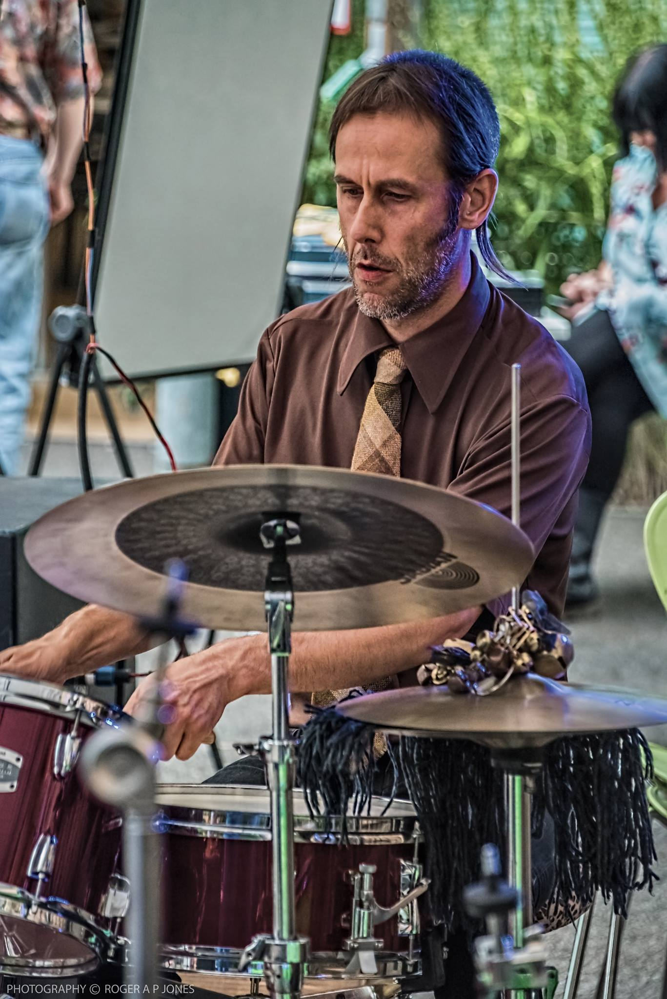 Lee Boys Allatson colour picture playing drums at an outdoor event