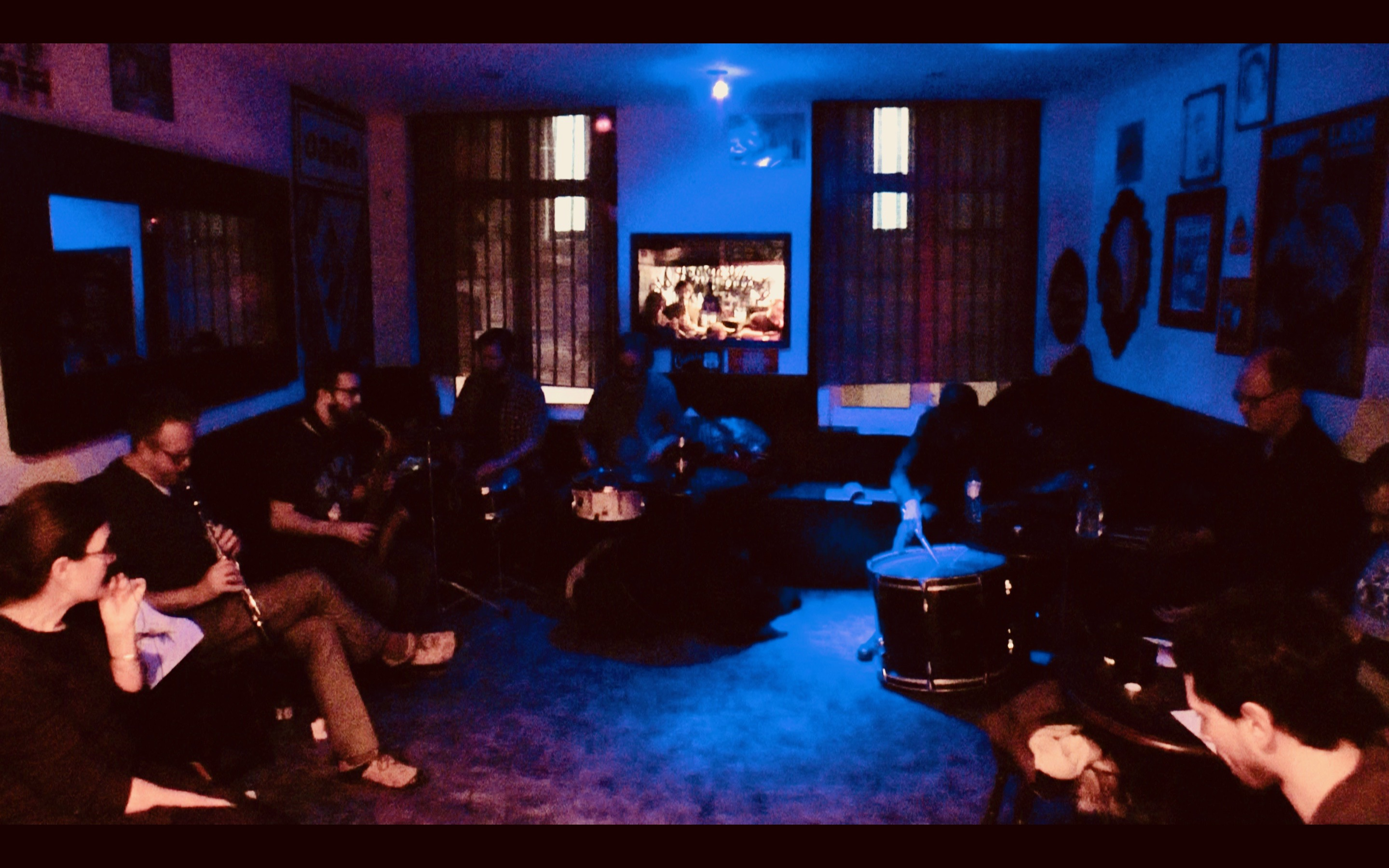 Mopomoso Workshop Group experimenting with emotional state motivators in their dark lit meeting space at Troy Bar, London