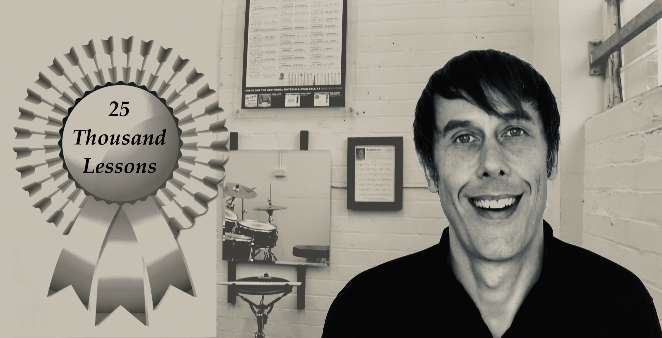 Lee Allatson with rosette celebrating 25,000 drum lessons